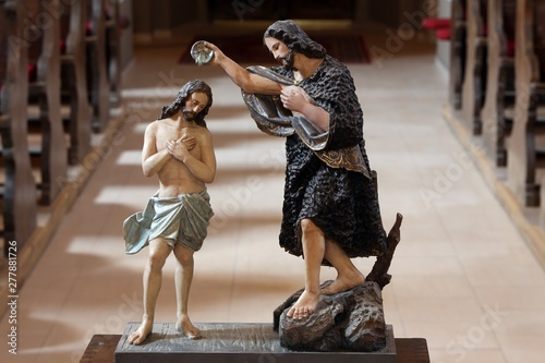 Obraz na plátne Baptism of the Lord statue on the baptismal font in the church of Saint Matthew