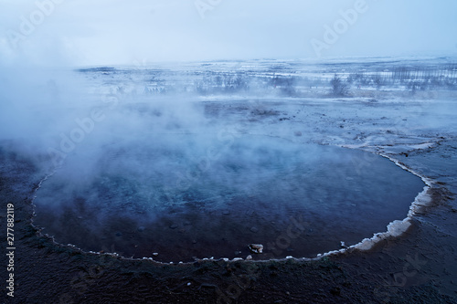 Canvas Print Geothermal lake (hot spring pool) with smoke in Iceland at geysir Strokkur, gold