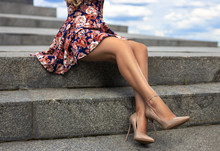 Girl With Perfect Legs At The City Square And The Sky.
