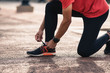 Young man running in the city. Healthy lifestyle concept. Young fitness man runner athlete running at park in morning.