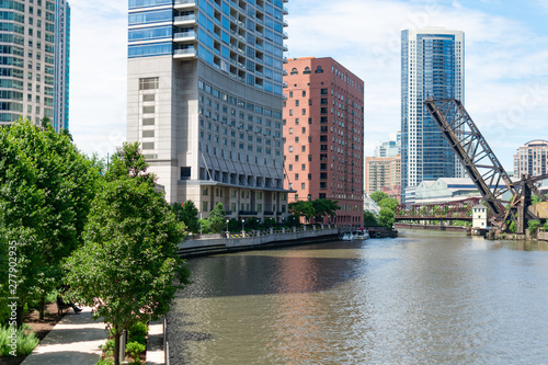 The Chicago River and Riverwalk looking towards the Raised Kinzie Street Railway Bridge with Skyscrapers