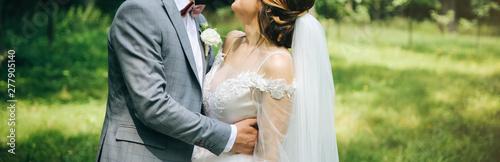Fotografie, Obraz  Bride and groom are hugging in the park