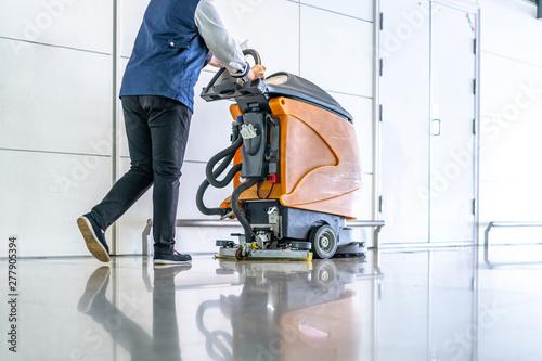 Fototapeta cleaning floor with machine obraz