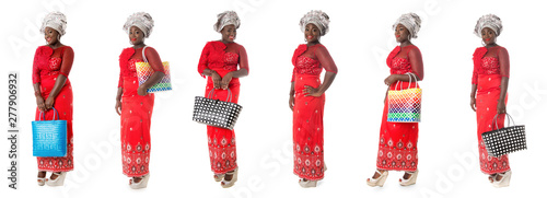 Fotografía  set of african woman in red taditional clothing with tote bags isolated