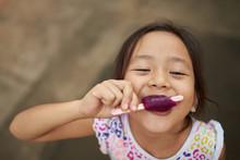 Asian Girl Eating Ice Cream In...