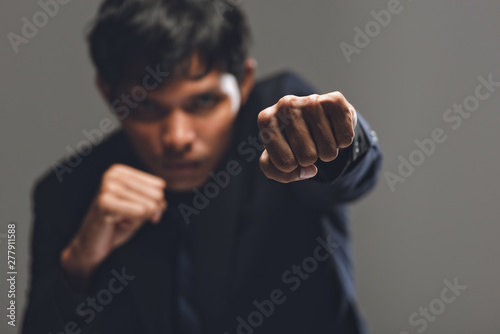 businessman as a successful fighter,Strong businessman boxing. Wallpaper Mural