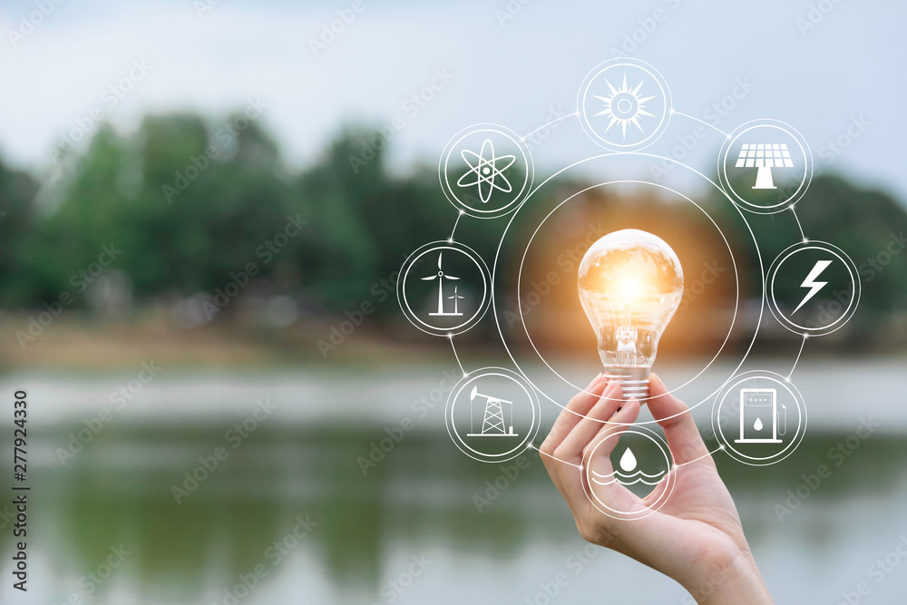 Fototapety, obrazy: Innovation and energy concept of hand hold a light bulb and copy space for insert text.