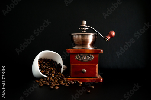 coffee grinder and beans on black background Canvas Print