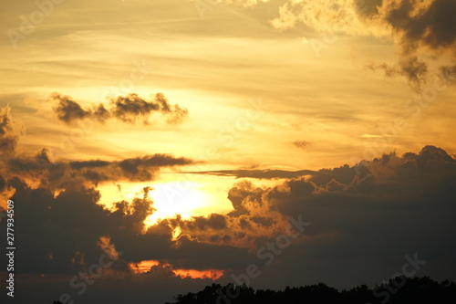 Brilliant Orange and Gold Sunset with Clouds
