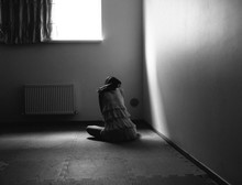 Female Silhouette On The Floor By The Window