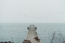 Wooden Dock On Cloudy Day With...