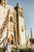 Man Tourist Standing Outside Catholic Church In Oaxaca Mexico