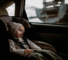 Toddler Sleeping In Carseat In Back Of Car
