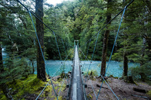 View Of Suspension Bridge Over River In Forest