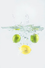 Lime And Lemon Falling In Water