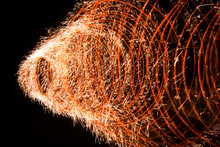 Spiral Of Fire That Explodes In Numerous Sparks