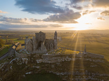 "The Famous Ireland Castle ""Rock Of Cashel"" On A Sunset"