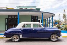 Blue Vintage Car Parked On Str...