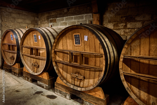 Tela Old oak cask of calvados in a cellar in Normandy, France