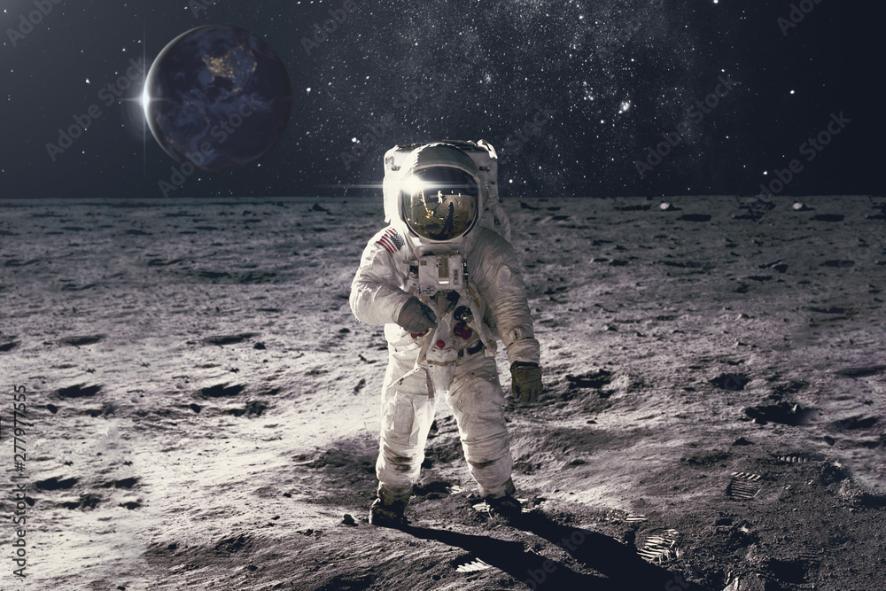 Fototapeta Astronaut on rock surface with space background. Elements of this image furnished by NASA