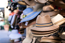 Stack Stacked Fedora Man Straw Hats On Retail Display Of Street Vendor Store With Many Colors In New Orleans, Louisiana