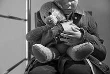Homeless Little Boy With Teddy Bear Sitting Indoors