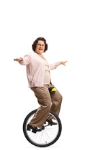 Senior Woman Riding A Unicycle And Smiling