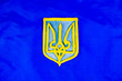 canvas print picture - Coat of arms of Ukraine against the flag - Independence Day.