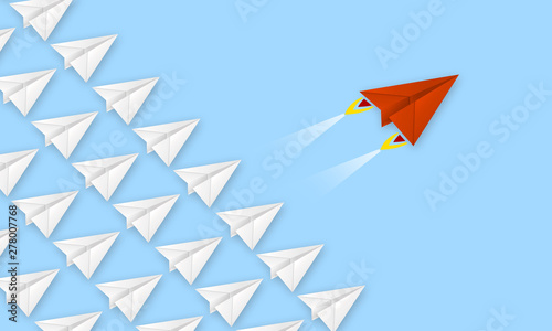 Photo Red plane made of paper metaphor for rev up to business success with blue backgr