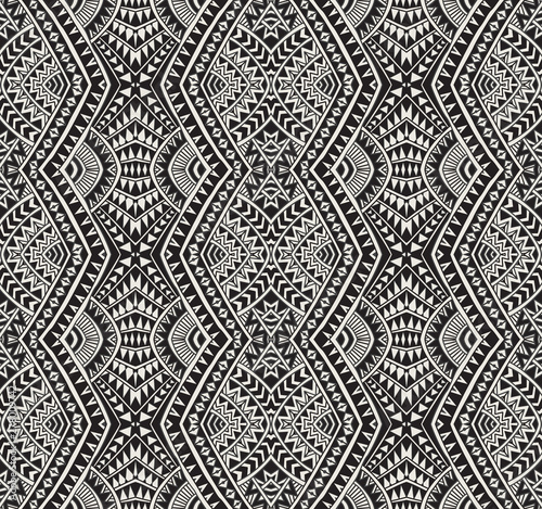 Cuadros en Lienzo Vector abstract seamless pattern from black, grey and light beige ikat geometrical shapes, rhombus, triangles, Maori ornaments, waves, stripes