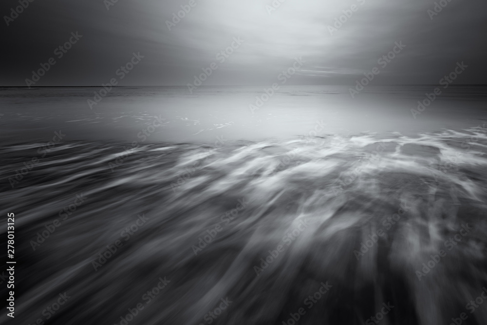 Fototapety, obrazy: A fine art seascape landscape in black and white of the beach with waves and dark clouds