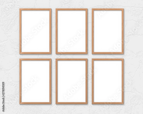 Set of 6 vertical wooden frames mockup with a border hanging on the wall. Empty base for picture or text. 3D rendering.