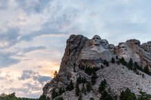 A Dramatically Colorful Sky Developing Around Sunset Behind The Four US Presidents Of Mount Rushmore, In North Dakota.