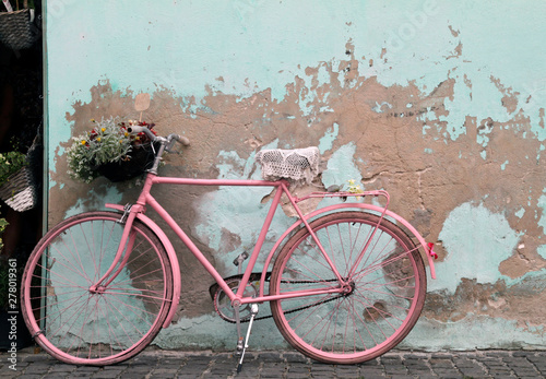 Recess Fitting Bicycle Vintage pink bicycle leaning against a wall in Havana, Cuba