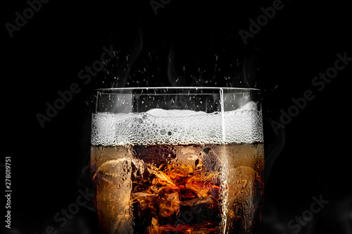 Soft drink glass with ice splash on cool smoke background Canvas Print