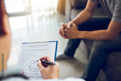 Obraz Asian doctor is examining the abnormal items of the body and diagnosing the disease in the paper with the medical report of the patient. - fototapety do salonu