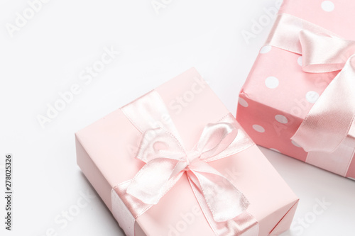Fototapeta Gift box wrapped in pastel  paper with pink ribbon isolated on white background obraz na płótnie