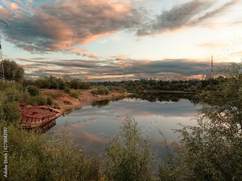 Foto op Plexiglas China GOMEL, BELARUS old rusty metal river barge on the bay