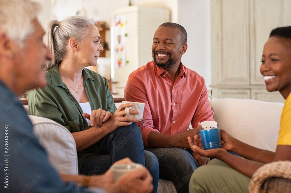 Fototapety, obrazy: Mature friends in conversation at home