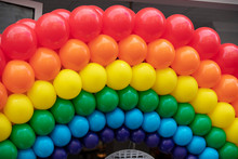 The LGBT Gay Pride Rainbow Flag Background Made From A Collection Of Balloons