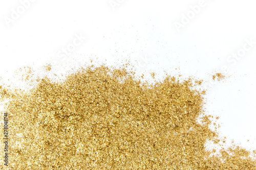 Fotografía  Golden glitter sparkle texture on white background.
