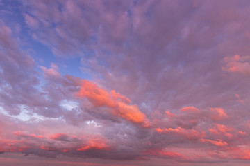 Overcast twilight sky with purple clouds. Abstract background for design.