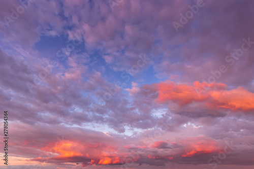 Foto op Aluminium Koraal Overcast twilight sky with purple clouds. Abstract background for design.