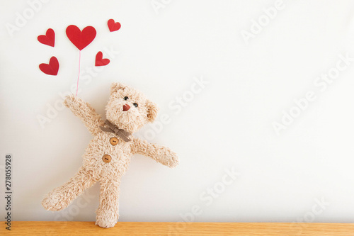 Cute teddy bear with red heart balloons, He happy and smiling, Happy Valentine's day concept.