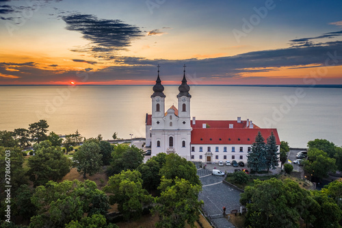 Foto auf Gartenposter Beige Tihany, Hungary - Aerial skyline view of the famous Benedictine Monastery of Tihany (Tihany Abbey) with beautiful colourful sky and clouds at sunrise over Lake Balaton