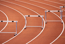 Hurdles On A Bend Of An Athletics Stadium Race Track