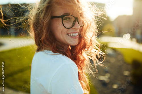 Portraits of a charming red-haired girl with a cute face Tableau sur Toile