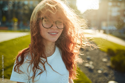 Fotografiet  Portraits of a charming red-haired girl with a cute face