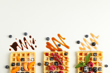 Flat Lay Composition With Belgian Waffles And Different Toppings, Top View