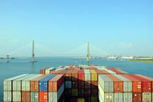 Container Ship Approaching To The  Arthur Ravenel Jr. Bridge In Charleston, South Caroline.
